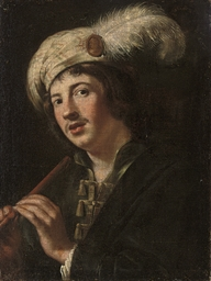 A man holding a flute