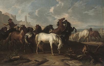 A drover herding horses along