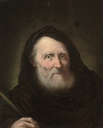 A hermit holding a quill