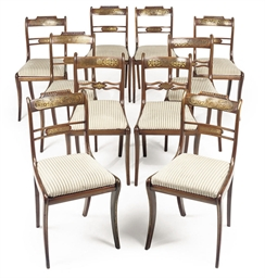 A MATCHED SET OF TWELVE REGENCY BRASS-INLAID DINING CHAIRS ...