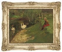Young girl on a riverbank watching geese