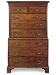 A GEORGE III MAHOGABY CHEST ON