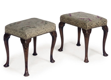 A PAIR OF WALNUT STOOLS