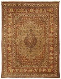An antique Tabriz rug