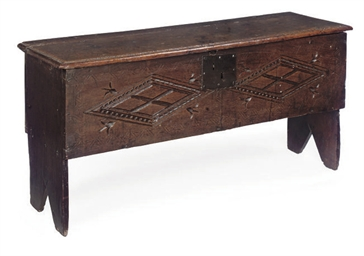 A CHARLES II OAK PLANK CHEST