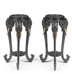 A PAIR OF ORIENTAL EBONISED UR
