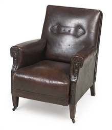 AN OAK CLUB ARMCHAIR