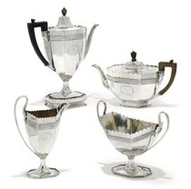 A VICTORIAN SILVER OCTAGONAL FIVE-PIECE TEA AND COFFEE SERVICE