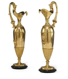 A PAIR OF EMPIRE ORMOLU EWERS