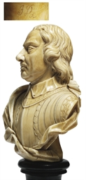 A CARVED IVORY BUST OF OLIVER