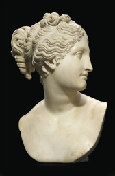 A CARVED MARBLE BUST OF VENUS
