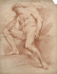 A seated male nude