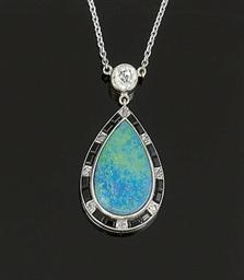A French art Deco opal, onyx a