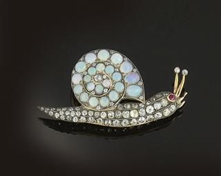 An opal and diamond snail broo