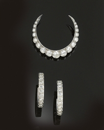 A diamond crescent brooch and