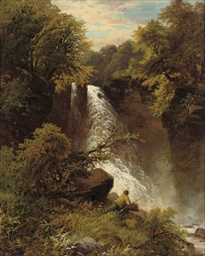 An angler before a waterfall
