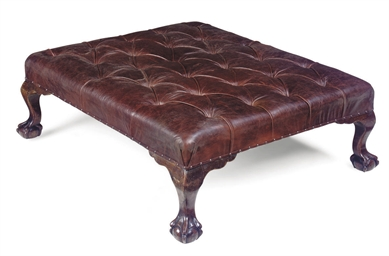 A LARGE BUTTONED-LEATHER STOOL