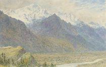 View across a plain towards snow-capped mountains