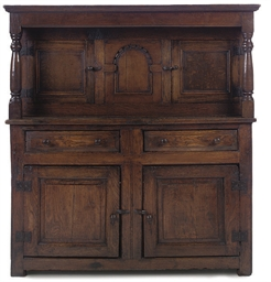 AN OAK CUPBOARD