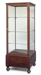 A MAHOGANY AND GLASS DISPLAY C