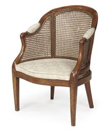 A FRENCH CANED FRUITWOOD BERGE