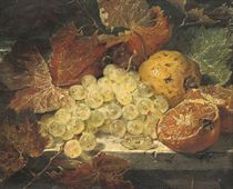 Grapes, an orange and a lemon with autumn leaves on a ledge