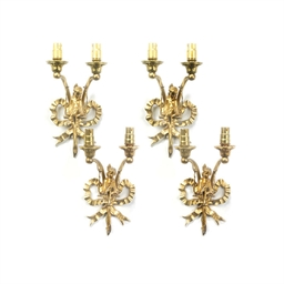 A SET OF FOUR GILT BRASS TWIN-