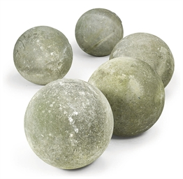 A GROUP OF FIVE STONE SPHERE F