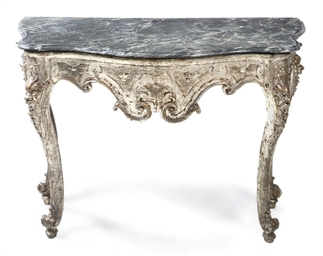 AN ITALIAN CARVED AND SILVERED