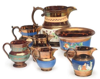 A GROUP OF SIX LUSTERWARE JUGS