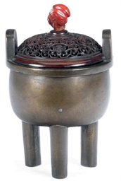 A CHINESE SILVER-INLAID BRONZE