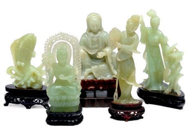 A GREENISH-WHITE JADE FIGURE O