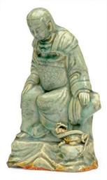 A CHINESE CELADON-GLAZED FIGUR