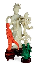 A CHINESE CARVED JADE FIGURE O