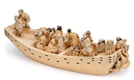 A JAPANESE IVORY MODEL OF A BO