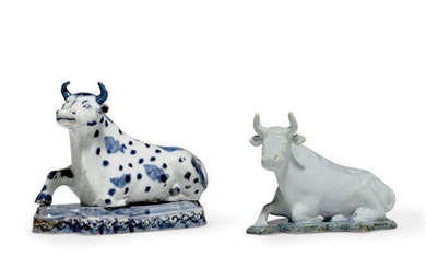 A JAPANESE PORCELAIN COW AND A