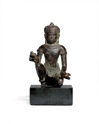 A RARE BRONZE KHMER FIGURE OF