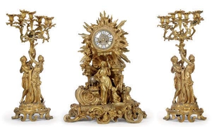 A FRENCH GILT-BRONZE FIGURAL CLOCK GARNITURE,
