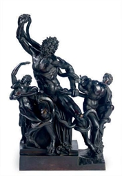 A PATINATED BRONZE GROUP OF LA
