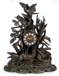 A BLACK FOREST FIGURAL MANTELC