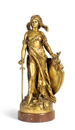 A GILT-METAL FIGURE EMBLEMATIC