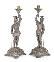 A PAIR OF SILVERED-METAL FIGUR