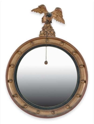 A GILTWOOD AND EBONIZED CONVEX