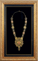 A FRAMED AND GLAZED GILT-METAL