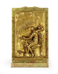 A GILT-BRONZE RELIEF OF A SEAT