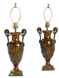 A PAIR OF PATINATED METAL URNS