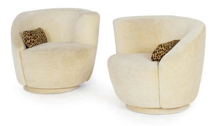 A PAIR OF UPHOLSTERED SWIVEL A