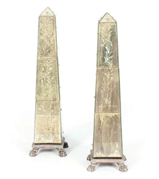 A PAIR OF MIRRORED AND SILVERE