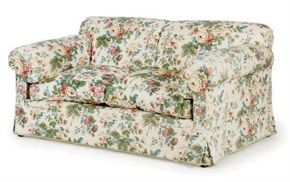 A CHINTZ UPHOLSTERED SOFA,