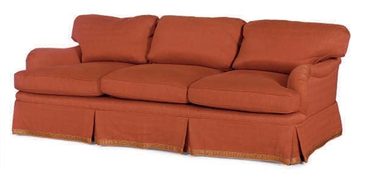 A RED-LINEN UPHOLSTERED SOFA,